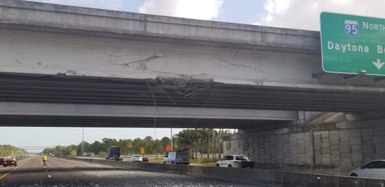 Tractor-trailer crash damages State Road 528 overpass on Interstate 95.
