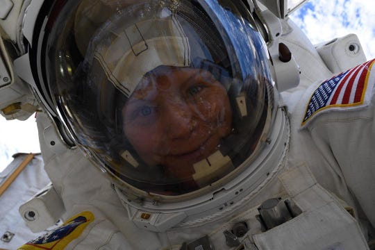 "NASA astronaut Anne McClain takes a ""space selfie"" with her helmet visor up 260 miles above the Earth's surface during a six-hour, 39-minute spacewalk March 22, 2019."
