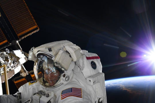 NASA astronaut Anne McClain takes her first spacewalk at the International Space Station on March 22.