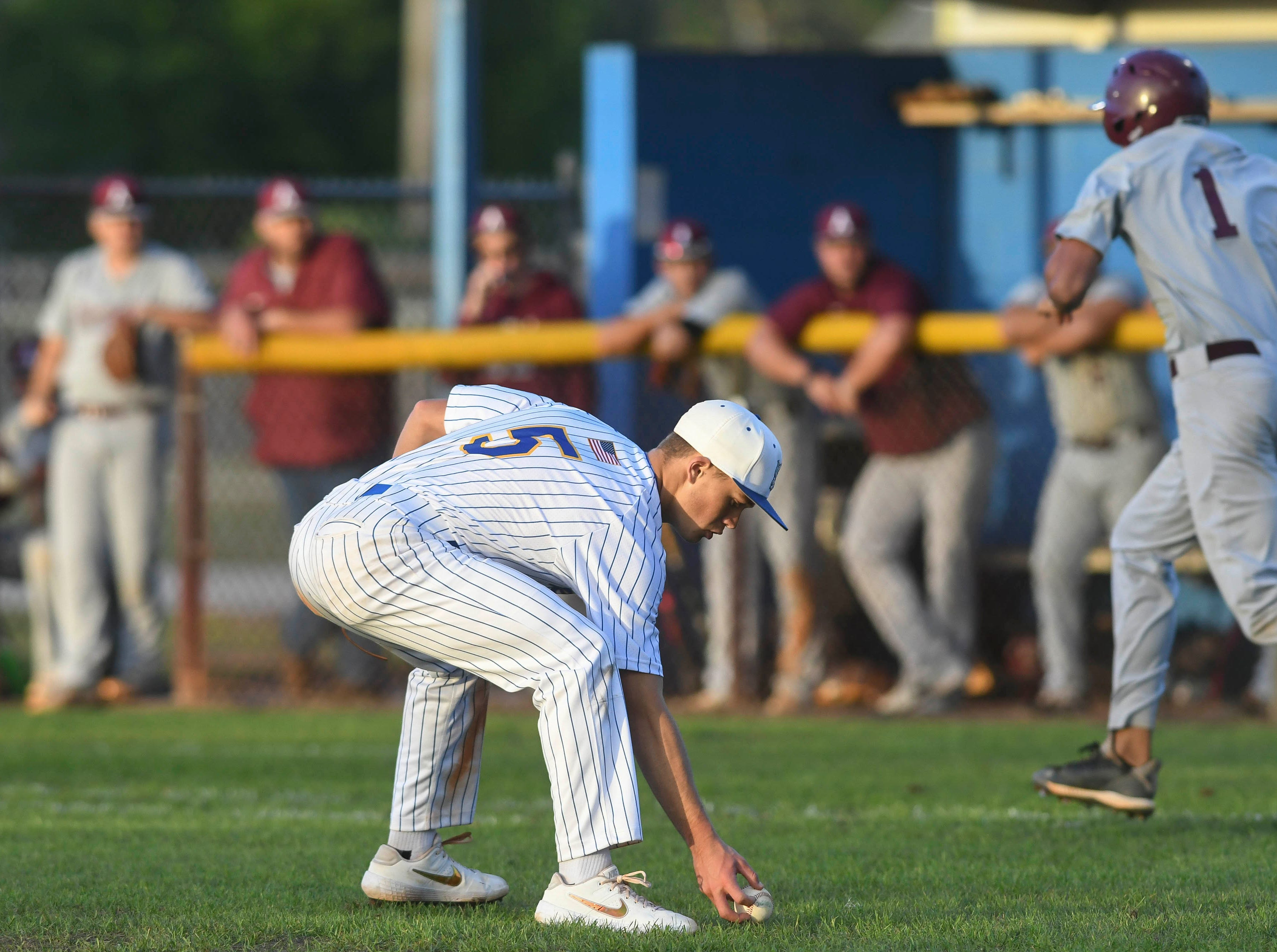 Titusville pitcher Jackson Woodward prepares to throw out Astronaut baserunner Daymon Woodraff during Thursday's game in Titusville.