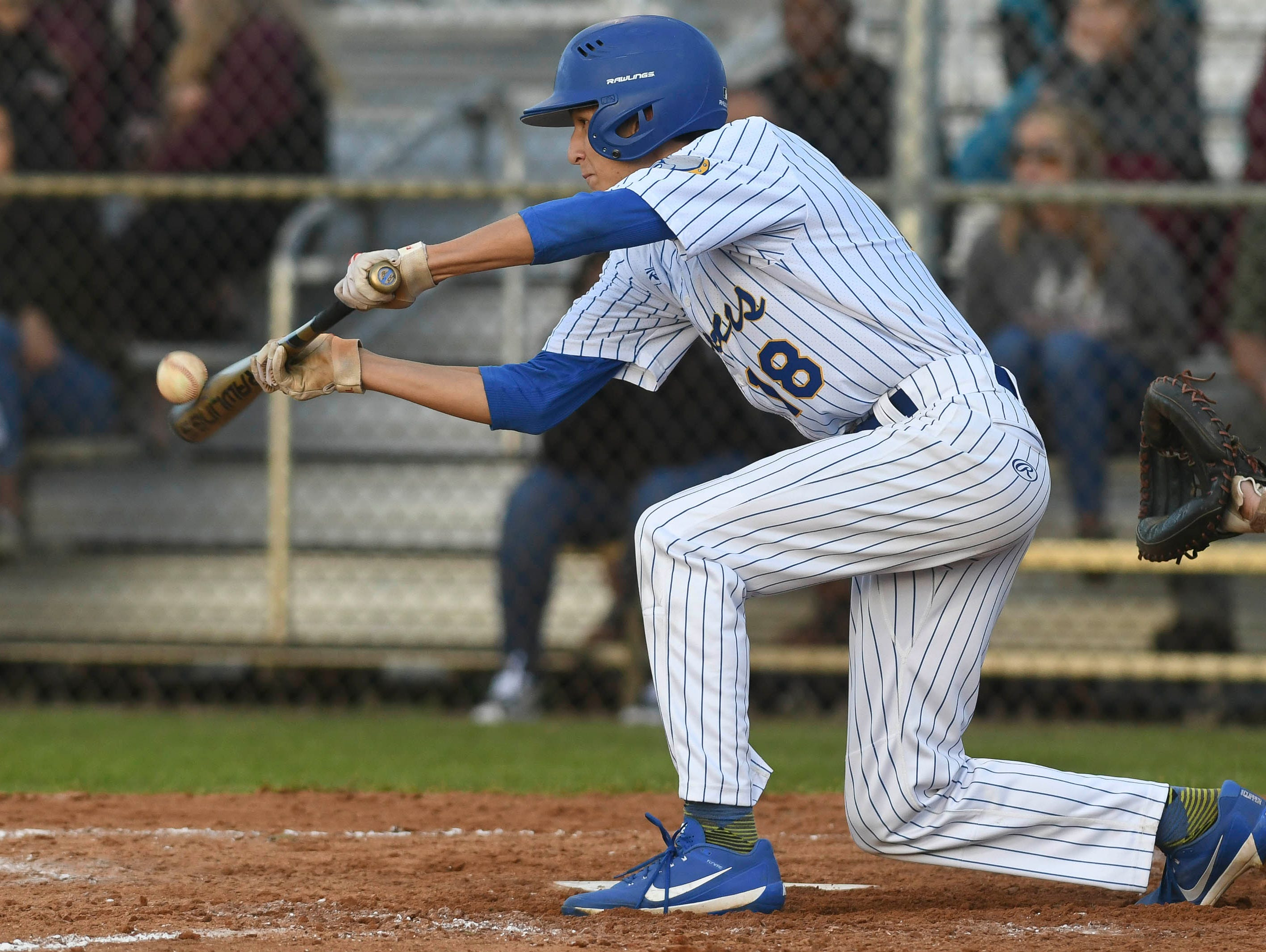 Titusville's Mikey Wiirre attempts a bunt during Thursday's game against Astronaut.