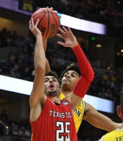March 28, 2019; Anaheim, CA, USA; Texas Tech Red Raiders guard Davide Moretti (25) moves to the basket against the Michigan Wolverines during the first half in the semifinals of the west regional of the 2019 NCAA Tournament at Honda Center. Mandatory Credit: Richard Mackson-USA TODAY Sports