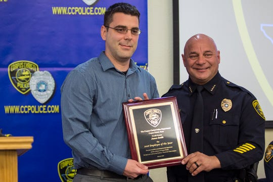 James Smith (left) takes a photo with Corpus Christi Police  Chief Mike Markle during the department's award ceremony on Friday, March 29, 2019. Smith was awarded with employee of th year.