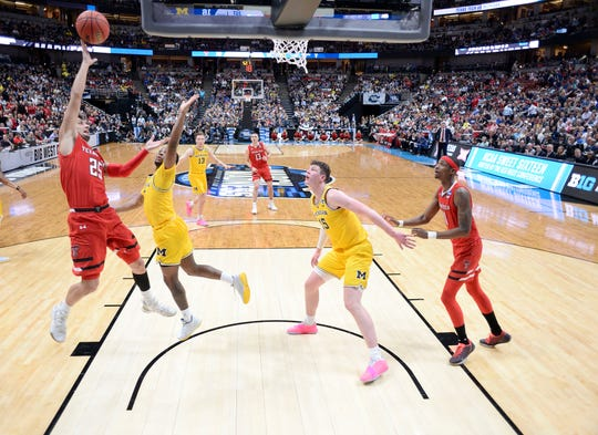 March 28, 2019; Anaheim, CA, USA; Texas Tech Red Raiders guard Davide Moretti (25) shoots against Michigan Wolverines guard Zavier Simpson (3) during the first half in the semifinals of the west regional of the 2019 NCAA Tournament at Honda Center. Mandatory Credit: Robert Hanashiro-USA TODAY Sports