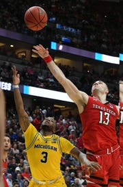 March 28, 2019; Anaheim, CA, USA; Michigan Wolverines guard Zavier Simpson (3) shoots against Texas Tech Red Raiders guard Matt Mooney (13) during the second half in the semifinals of the west regional of the 2019 NCAA Tournament at Honda Center. Mandatory Credit: Richard Mackson-USA TODAY Sports
