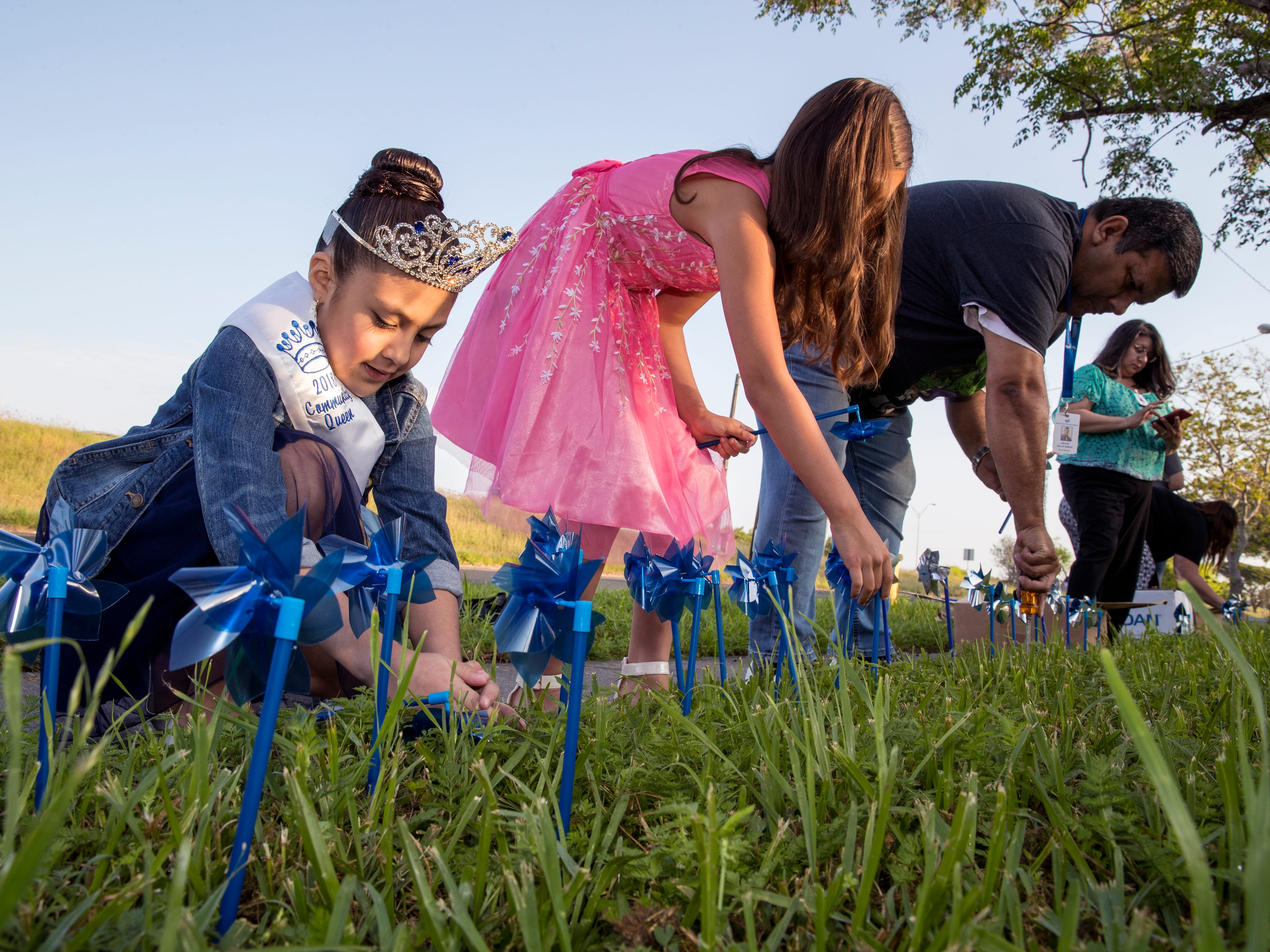 Salina Ramirez (left), 8, and Anesa Hernandez, 9, help install pinwheels in front of CASA of the Coastal Bend on Friday, March 29, 2019. The 1,066 pinwheels represent a child from the Coastal Bend who was in foster care last year and will stay up throughout the month of April, which is Child Abuse Awareness Month.
