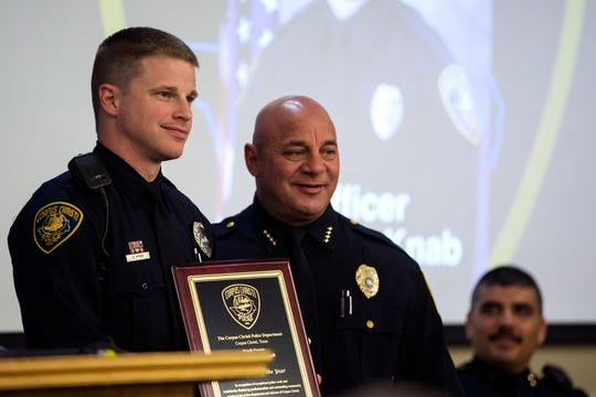 Corpus Christi Police Officer Dominic Knab (left) takes a photo with Police Chief Mike Markle during the department's award ceremony on Friday, March 29, 2019. Knab was awarded with officer of the year.