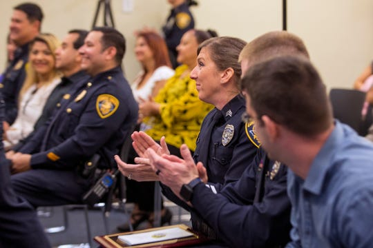 Corpus Christi Police Senior Officer Crystal Bustamante (right) was recognized as investigator of the year during the department's award ceremony on Friday, March 29, 2019.