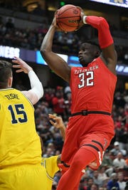 March 28, 2019; Anaheim, CA, USA; Texas Tech Red Raiders center Norense Odiase (32) grabs a rebound against Michigan Wolverines center Jon Teske (15) during the first half in the semifinals of the west regional of the 2019 NCAA Tournament at Honda Center. Mandatory Credit: Richard Mackson-USA TODAY Sports
