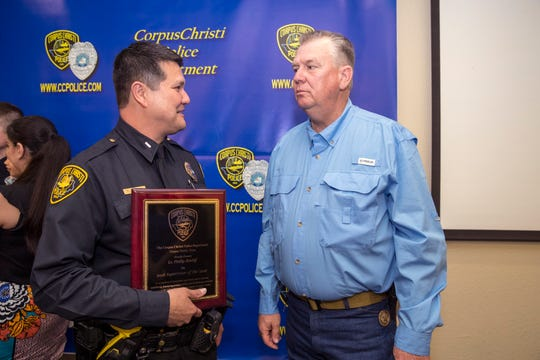 Corpus Christi Police Lt. Phillip Binttliff (left) talks with retired game warden Captain Kevin McDonald following the department's award ceremony on Friday, March 29, 2019. Bintliff was awarded supervisor of the year during the ceremony.