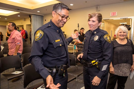 Corpus Christi Police Lt. Mike Pena congratulates Senior Officer Crystal Bustamante who was awarded investigator of the year during the department's award ceremony on Friday, March 29, 2019.