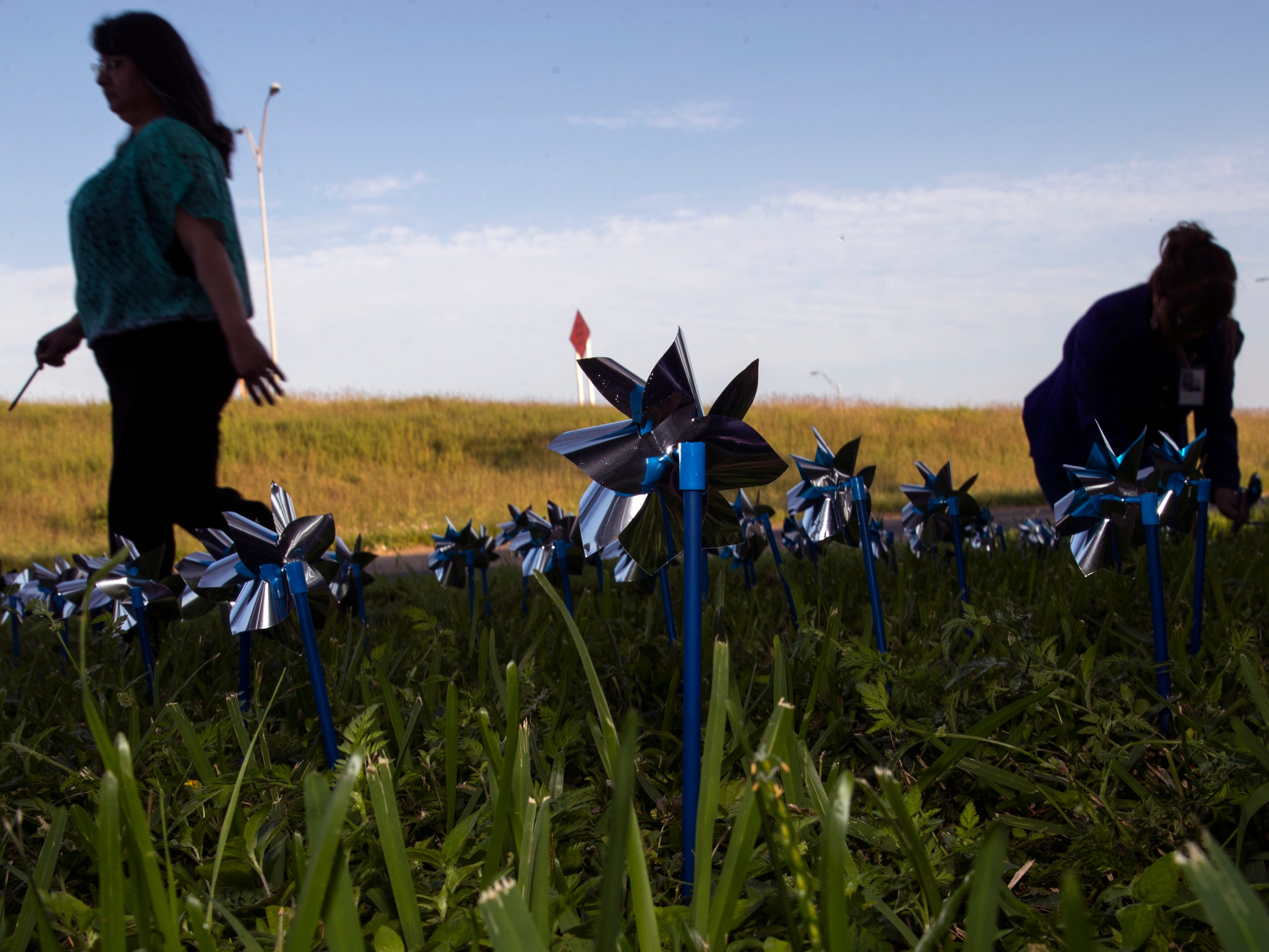 Pinwheels are installed in front of CASA of the Coastal Bend on Friday, March 29, 2019. The 1,066 pinwheels represent a child from the Coastal Bend who was in foster care last year and will stay up throughout the month of April, which is Child Abuse Awareness Month.