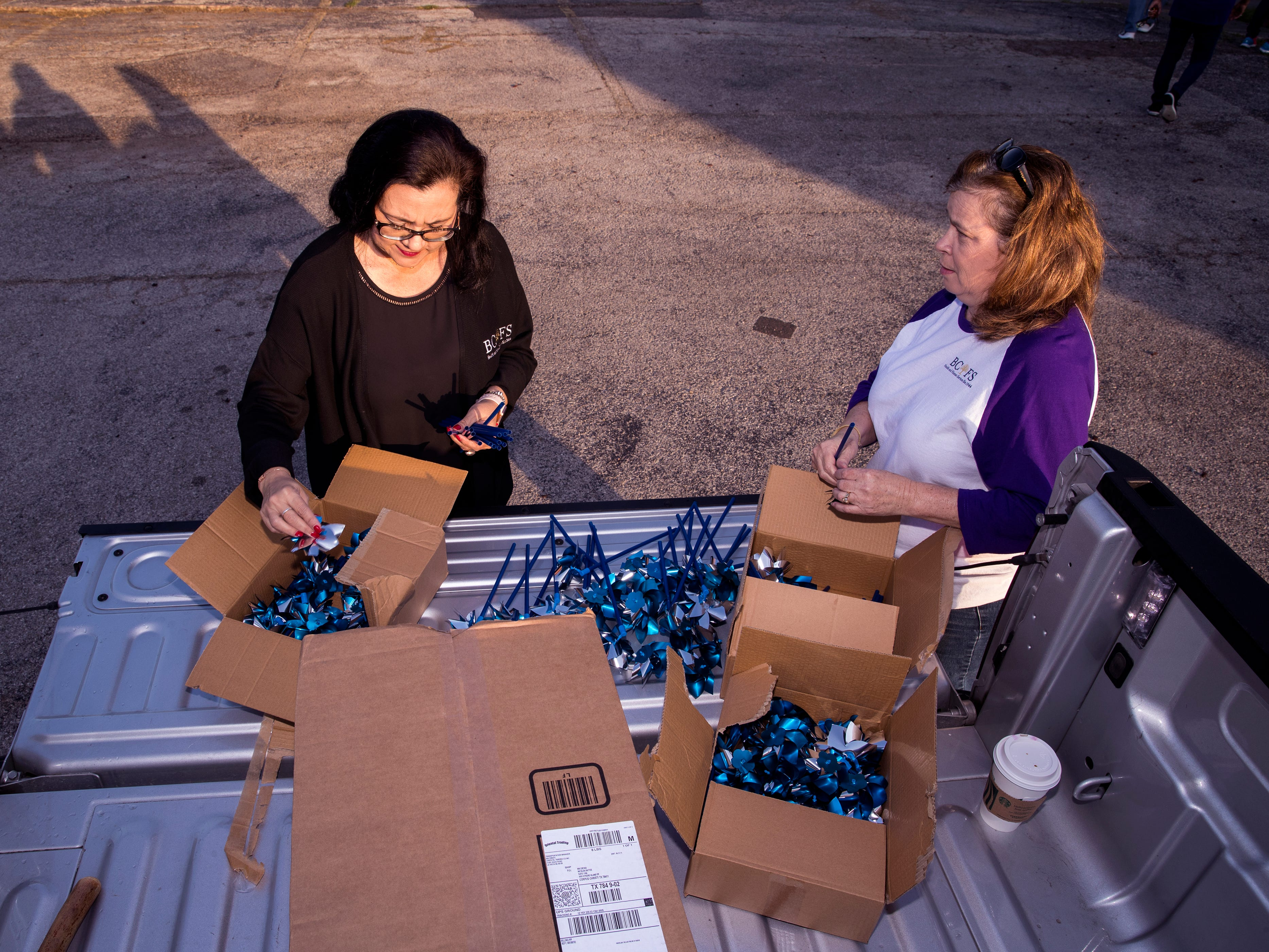 Marissa Cano (left) and Noemi Gomez assemble pinwheels to be installed in front of CASA of the Coastal Bend on Friday, March 29, 2019. The 1,066 pinwheels represent a child from the Coastal Bend who was in foster care last year and will stay up throughout the month of April, which is Child Abuse Awareness Month.