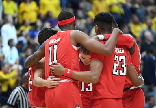 March 28, 2019; Anaheim, CA, USA; Texas Tech Red Raiders starters gather before playing against Michigan Wolverines in the semifinals of the west regional of the 2019 NCAA Tournament at Honda Center. Mandatory Credit: Robert Hanashiro-USA TODAY Sports