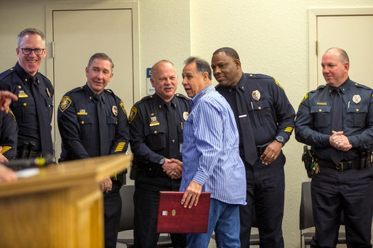 Corpus Christi Police Department volunteer Jesse Fuentes (center) was recognized as the department's volunteer of the year during the department's award ceremony on Friday, March 29, 2019.