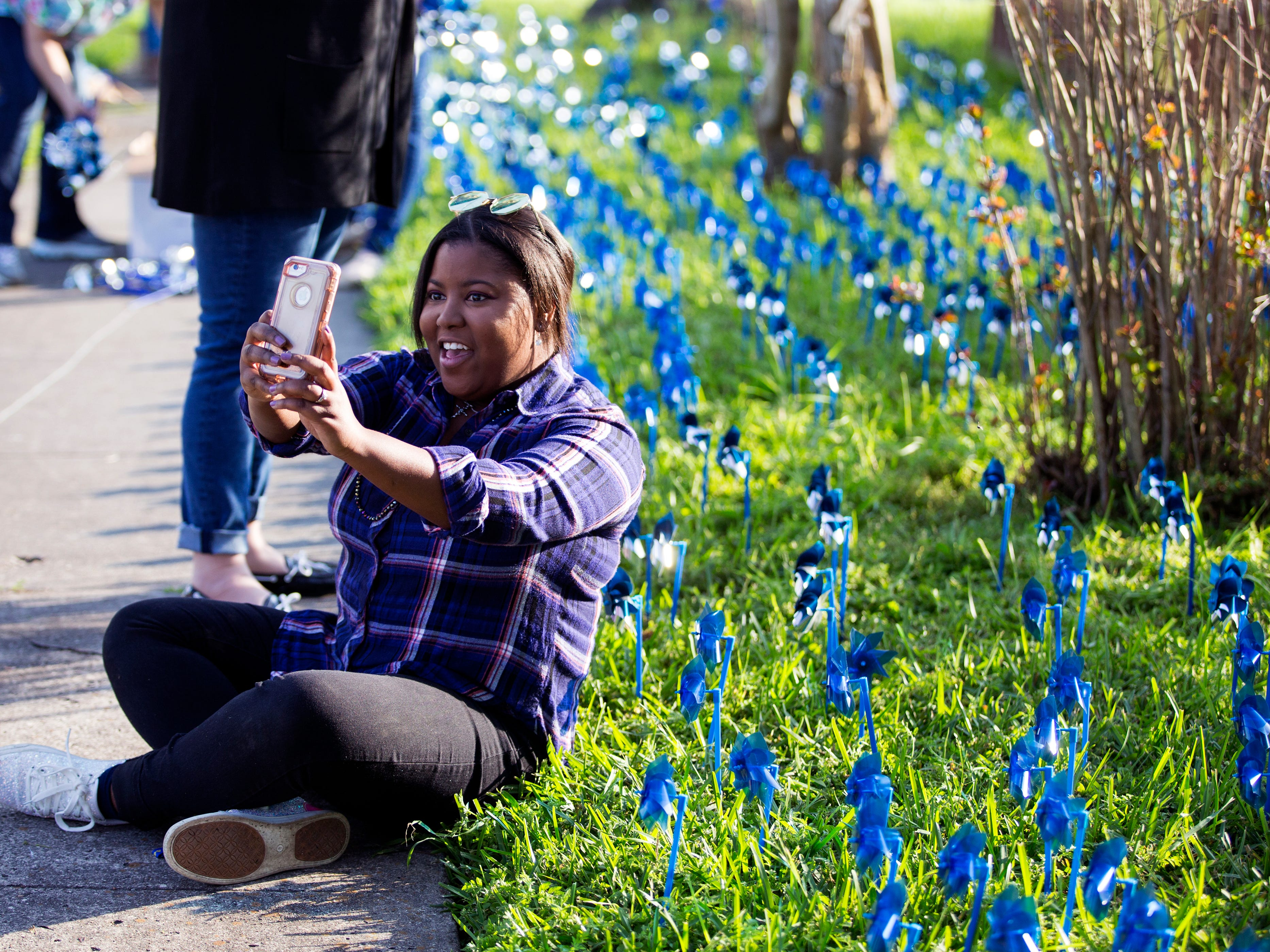 Ruthie Johnson takes a selfie after helping install pinwheels in front of CASA of the Coastal Bend on Friday, March 29, 2019. The 1,066 pinwheels represent a child from the Coastal Bend who was in foster care last year and will stay up throughout the month of April, which is Child Abuse Awareness Month.