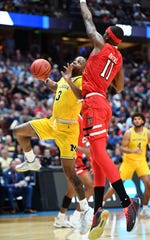 March 28, 2019; Anaheim, CA, USA; Michigan Wolverines guard Zavier Simpson (3) moves to the basket against Texas Tech Red Raiders forward Tariq Owens (11) during the first half in the semifinals of the west regional of the 2019 NCAA Tournament at Honda Center. Mandatory Credit: Robert Hanashiro-USA TODAY Sports