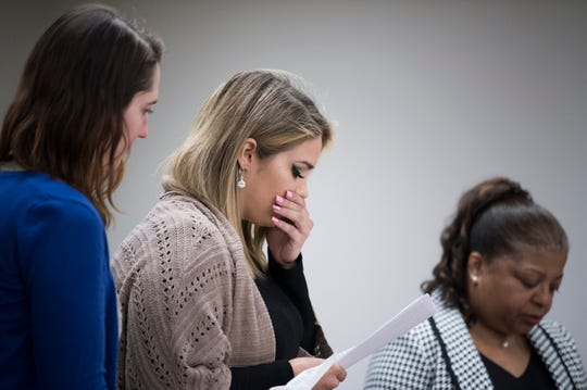 A.S., 20, pauses while reading a victim impact statement during the sentencing of her assailant Mason Mallon Friday, March 29, 2019 at Camden County Hall of Justice in Camden, N.J.