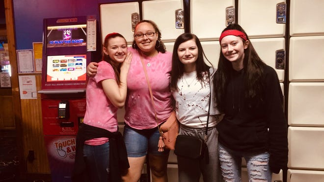 Shianna Roll, Sierra Saxon, Brynn Justice and Carolyn Hubbard at a FCCLA fundraiser event last month. The group is working towards deregulating school lunches.