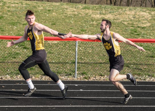 Paint Valley's Caleb Adams hands off to Justin Draise in the 4x100 meter race earlier in the year at the Zane Trace invitational.
