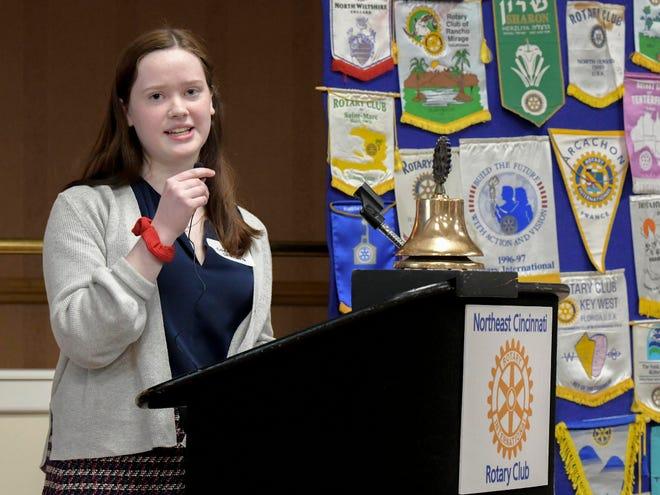 Caroline Skwara accepts Student of Month award.