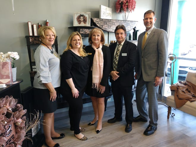 Left to right: Trustee Rose Stertz, owner Amanda (Mandie) Becker, trustee Cheryl Sieve, trustee Mike Davis, fiscal officer Jim Luebbe.