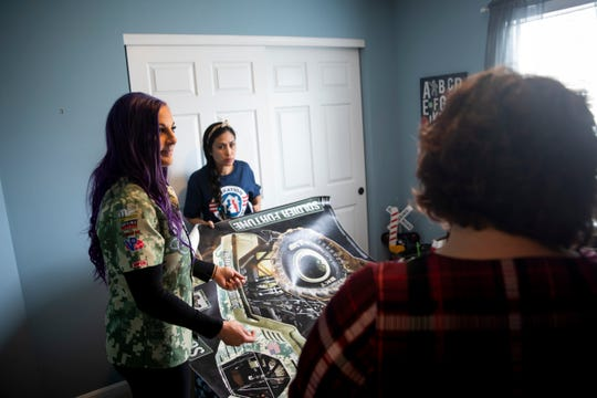 Monster Jam Driver Kayla Blood and volunteers from Operation Homefront decorate Brendan Hogan's room before he comes home from preschool Friday, March 29, 2019 in Batavia.