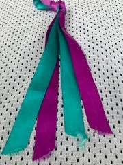 The ribbons worn by St. Ursula lacrosse players in their game against Turpin on Tuesday, March 26 in recognition of suicide prevention.
