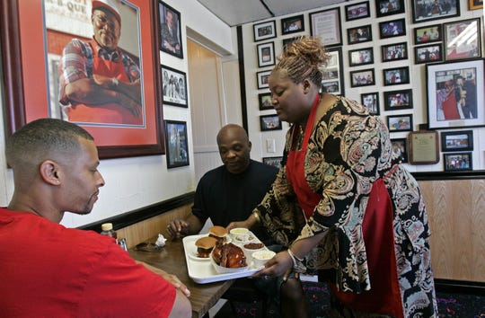 Denetra Seymour serves two customers at Big Daddy's BBQ in 2011.