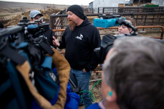 Scott Shehan, one of the people helping organize donations of hay for farmers impacted by flooding talks to members of the media, on Thursday, March 28, 2019, near Malvern.