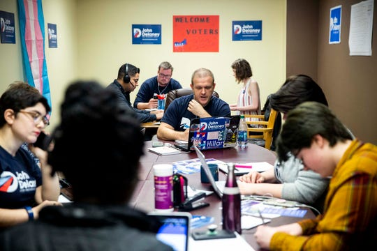 Staff and volunteers for John Delaney's presidential campaign make phone calls to encourage Iowans to attend an upcoming event with the presidential hopeful on Wednesday, March 27, 2019, at Delaney's field office in Des Moines.