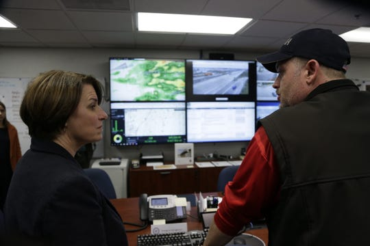Democratic presidential candidate Sen. Amy Klobuchar, D-Minnesota, talks to Pottawattamie County emergency management director Doug Reed on Friday, March 29, 2019, in Council Bluffs during a campaign stop in which she touted her plan for infrastructure.