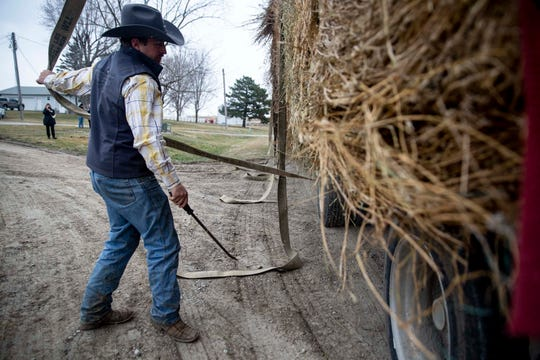 Paden Lawler delivers 28 bales of donated hay for farmers impacted by flooding, on Thursday, March 28, 2019, near Malvern.