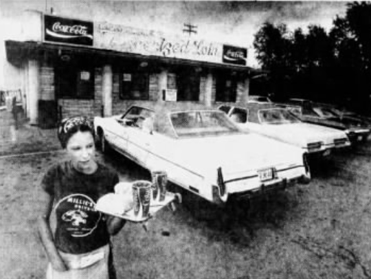 Waitress Diane Ziebell stands outside of Millie's Drive-In in 1978.