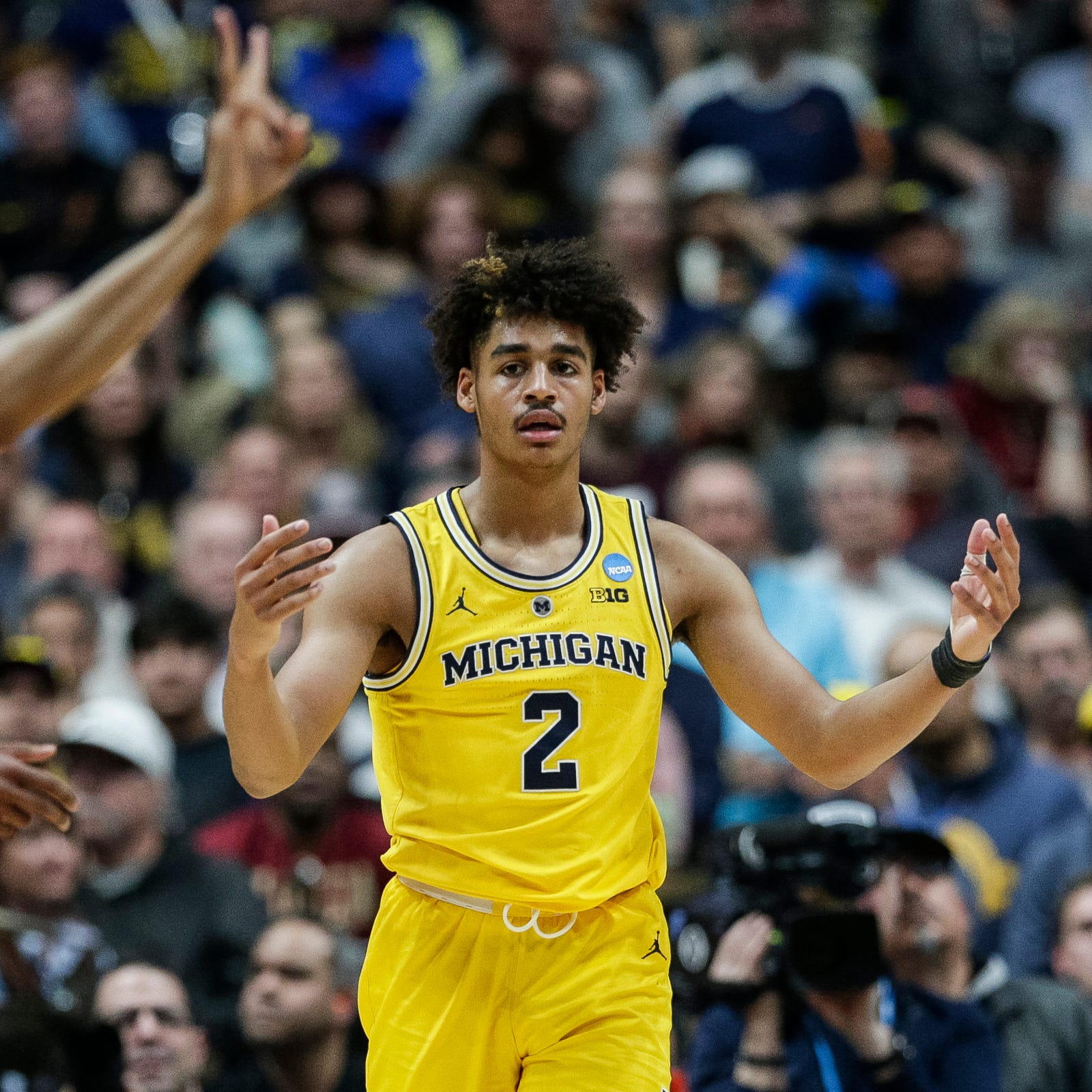 Michigan's Jordan Poole believes he's a pro, but will weigh options