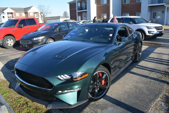Capt. Andy Chandler of the Evansville, Indiana, Police Department says theft of this Mustang Bullitt is under investigation. The car is chipped and scratched from going through windows of a dealership sometime overnight March 26-27, 2019.