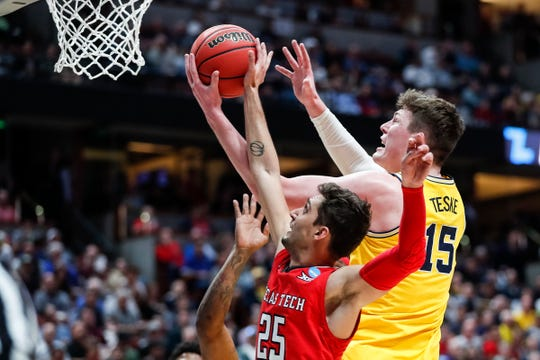 Michigan center Jon Teske (15) and Texas Tech guard Davide Moretti (25) battle for a rebound during the first half of the Sweet 16 game at Honda Center in Anaheim, Calif., Thursday, March 28, 2019.
