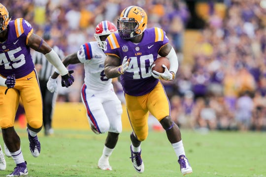 LSU Tigers linebacker Devin White returns a fumble against Louisiana Tech, Sept. 22, 2018.