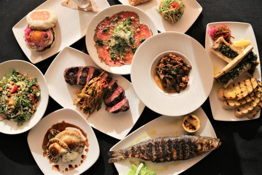 A spread of food from Michael Symon's Roast in Detroit.