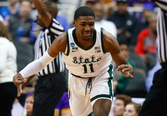 Michigan State forward Aaron Henry gestures after making a 3-pointer against LSU during the first half of an East Regional semifinal in the NCAA tournament in Washington, Friday, March 29, 2019.