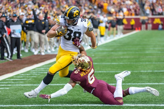 Iowa Hawkeyes tight end T.J. Hockenson scores a touchdown on a fake field goal attempt against Minnesota, Oct. 6, 2018.