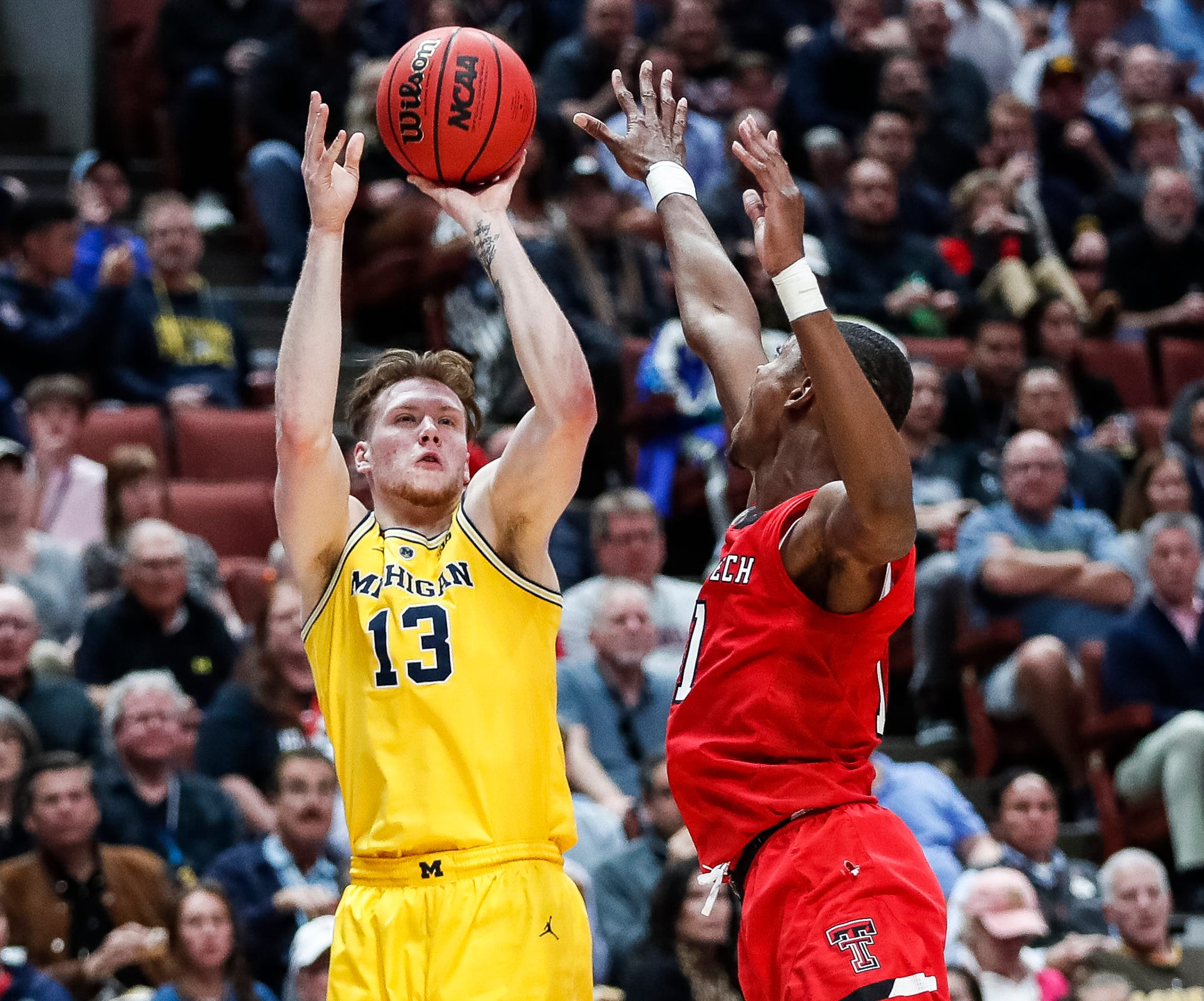Michigan forward Ignas Brazdeikis (13) attempts for a 3-point basket against Texas Tech guard Kyler Edwards (0) during the first half of the Sweet 16 game at Honda Center in Anaheim, Calif., Thursday, March 28, 2019.