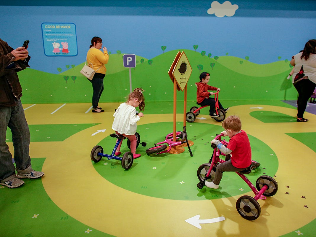 Children ride bikes around Danny Dog's garage play area at Peppa Pig World of Play attraction at Great Lakes Crossing in Auburn Hills, Mich. photographed on Friday, March 29, 2019.