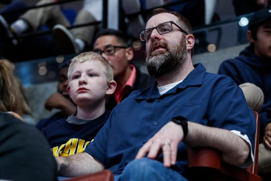 Gregg Nigl and his son Kaiden Nigl, 9, both of Columbus, Ohio, watch the Gonzaga-Florida State game at the Honda Center in Anaheim, Calif., Thursday, March 28, 2019.