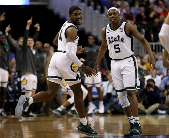 Michigan State's Aaron Henry, left, and Cassius Winston celebrate a basket during the first half in the East Region semifinal of the NCAA tournament at Capital One Arena on March 29, 2019 in Washington, D.C.