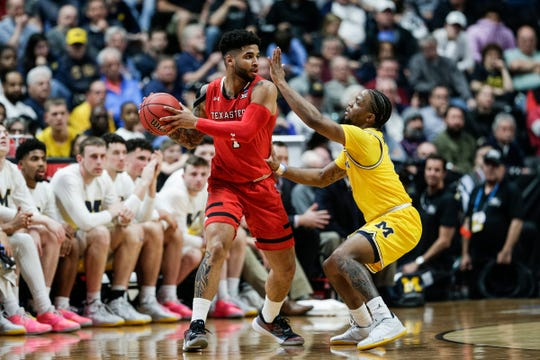 Michigan guard Zavier Simpson (3) defends Texas Tech guard Brandone Francis (1) during the first half of the Sweet 16 game at Honda Center in Anaheim, Calif., Thursday, March 28, 2019.