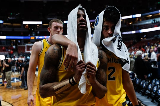 Michigan guard Charles Matthews (1) and guard Jordan Poole (2) walk off the court after the Wolverines lost 63-44 to Texas Tech at the Sweet 16 game at Honda Center in Anaheim, Calif., Thursday, March 28, 2019.