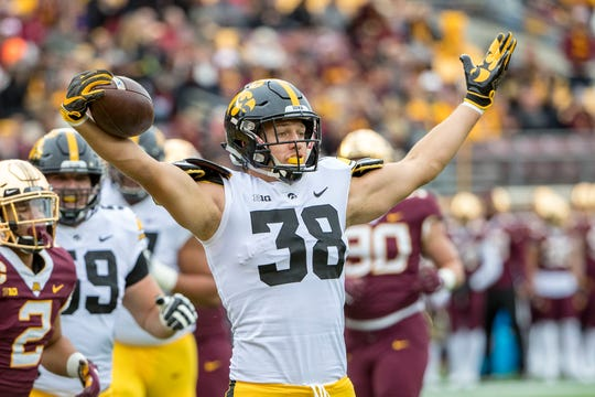 Iowa Hawkeyes tight end T.J. Hockenson celebrates after scoring a touchdown.
