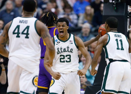 Michigan State's Xavier Tillman with teammates Nick Ward and Aaron Henry after scoring against LSU on Friday.
