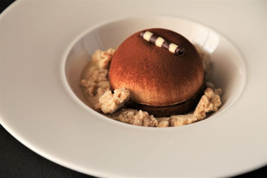 The tiramisu bomb dessert from Michael Symon's Roast in Detroit.